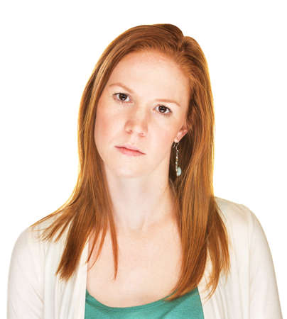 tilted: Serious woman with tilted head and blank stare