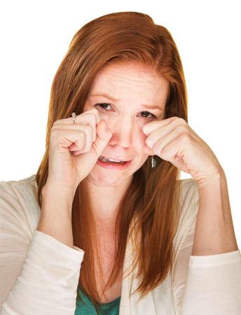 sobbing: Isolated beautiful sobbing female rubbing her eyes