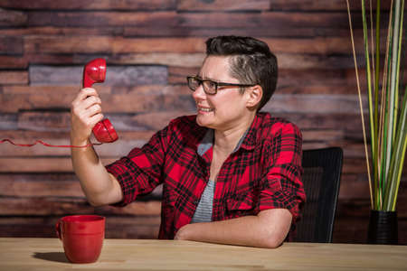 lesbian: Single frustrated young women on a stressful phone call
