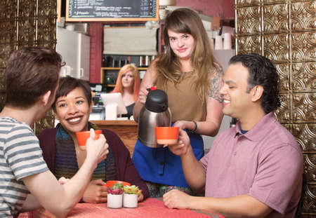 patron: Group of happy customers being served coffee by waitress Stock Photo