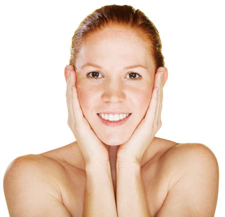cheek: Smiling young woman with hands on face