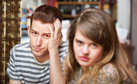 shoulder problem: Close up of frustrated young couple in coffee house