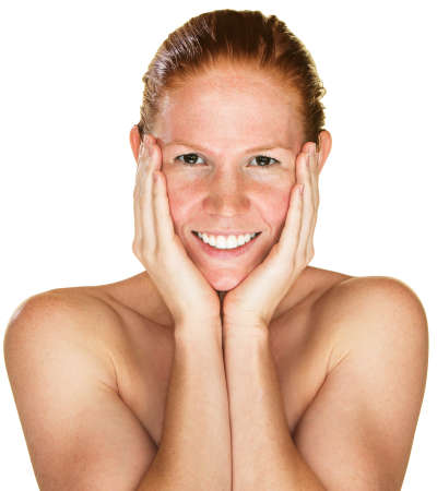natural face: Isolated laughing woman with bare shoulders holding face Stock Photo