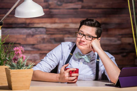 cheek to cheek: Lesbian woman with eyeglasses and hand on cheek Stock Photo