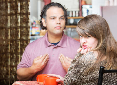 Arguing man and woman in coffee house