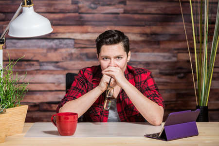 yuppie: Tense office worker with hands over her mouth