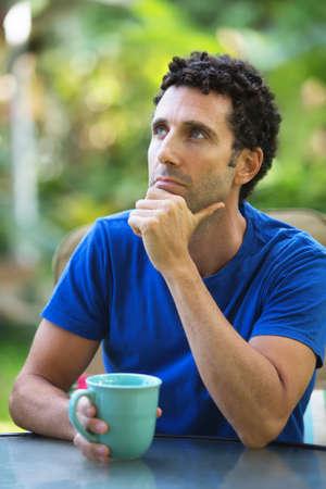 maui: Pensive Caucasian adult sitting outdoors in Maui