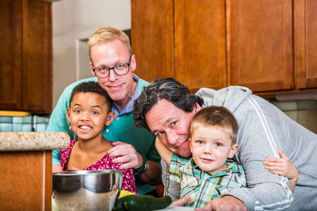 diverse family: men their kids in a residential kitchen