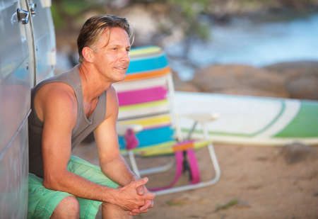 easygoing: Single cheerful adult Caucasian male outdoors at beach Stock Photo