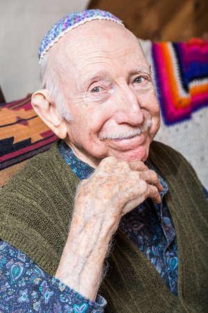 yarmulke: Elderly gentleman wearing a yarmulke smiling at the camera Stock Photo