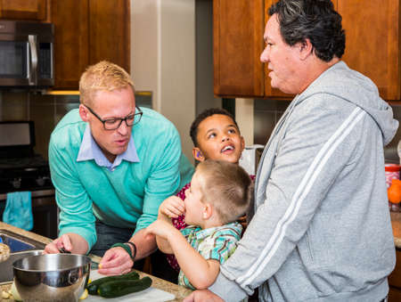 diverse family: men  and kids in their home kitchen