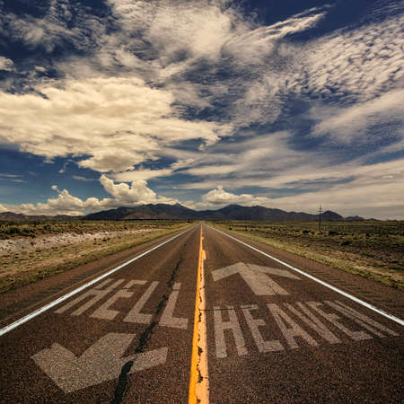 Conceptual image of two way road with arrows to heaven and hell