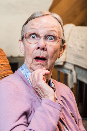 Surprised old matron woman looking at camera