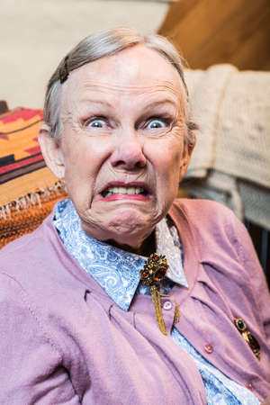 surly: Woman making a scary face at the camera Stock Photo