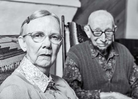 grumpy: Grumpy woman and man looking at camera skeptically Stock Photo