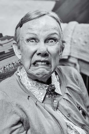Elderly woman making a scary face at the camera