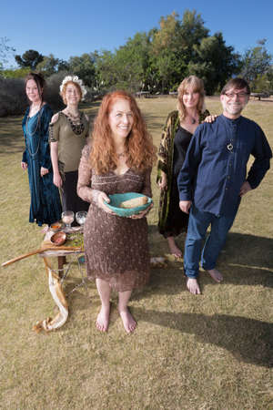 smudge: Group of modern witches smiling with altar and smudge stick