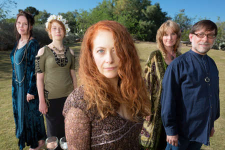 priestess: Women and man standing outdoors in pagan ritual clothing Stock Photo
