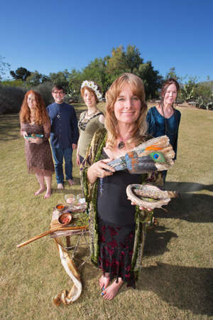 priestess: Male and female pagan group with sage incense Stock Photo