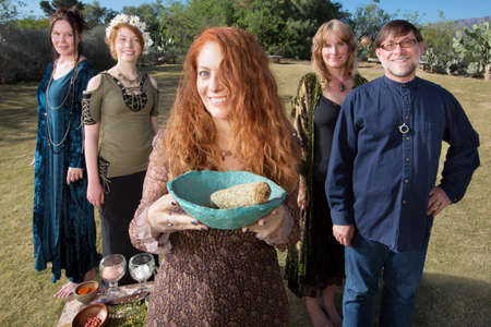 pagan: Smiling woman with bowl and sage incense and friends