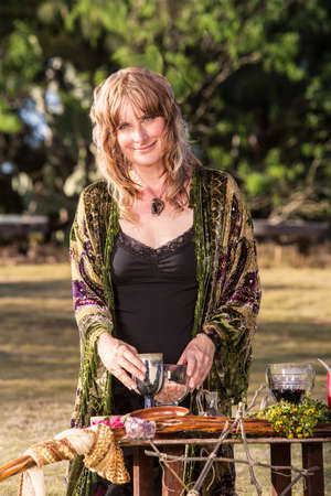 pagan: Smiling adult in outdoor pagan ritual practice