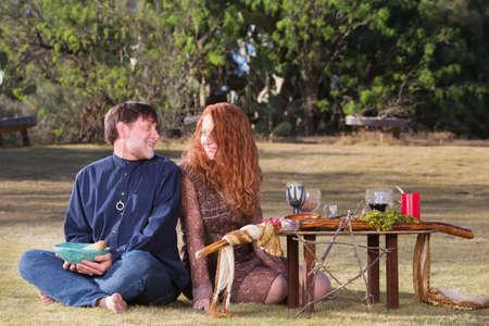 pagan: Happy pagan couple at altar with woodland pentagram
