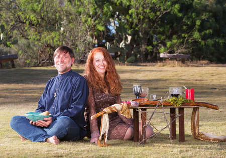 pagan: Happy pagan couple at altar with candles and goblets