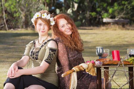 pagan: Pair of smiling women at outdoor pagan altar Stock Photo