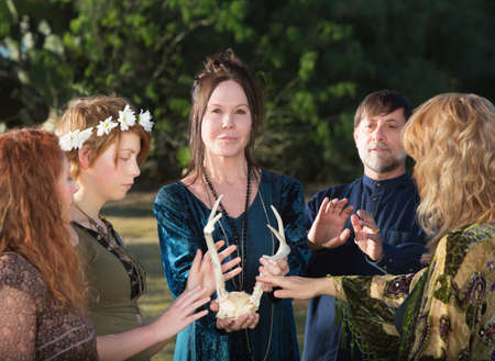 wicca: Group of adults in Wicca ceremony holding animal antlers