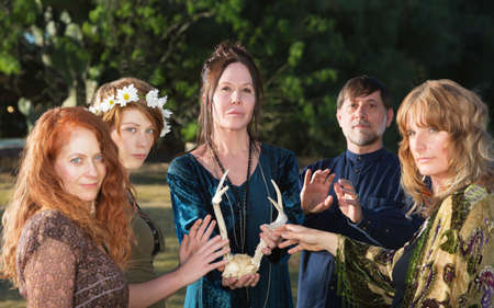 Adults in pagan ceremony feeling mystical power of antlers