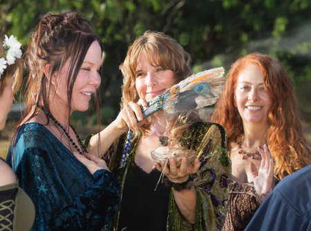 Male and female witches using feather and incense Stockfoto