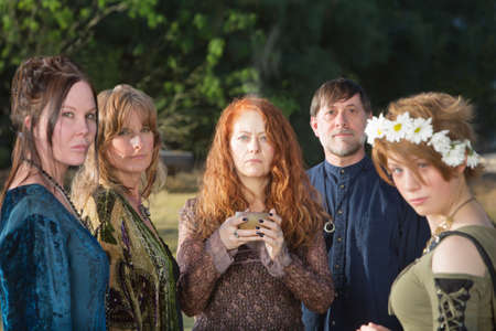 rituals: Adults in Wicca ceremony outdoors with incense bowl Stock Photo