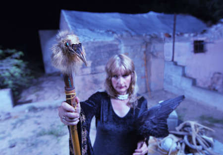 occult: Occult woman in black with crow wings and bird head