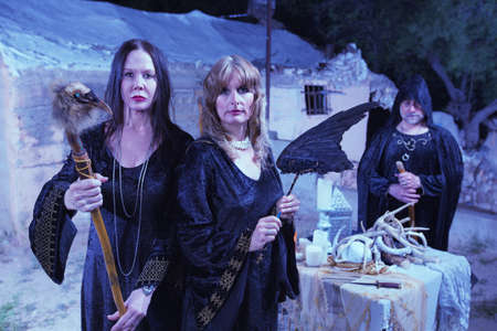 priestess: Group of witches with fetishes in worship ritual Stock Photo
