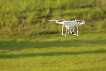 mid air: Remote control drone flying in mid air over a field