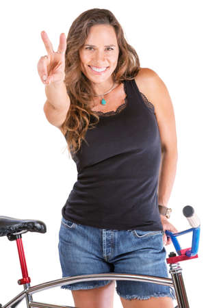 cruiser bike: Isolated cute woman gesturing victor symbol with her bike Stock Photo