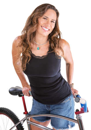 cruiser bike: Cheerful Hispanic woman in blue jeans shorts with bike