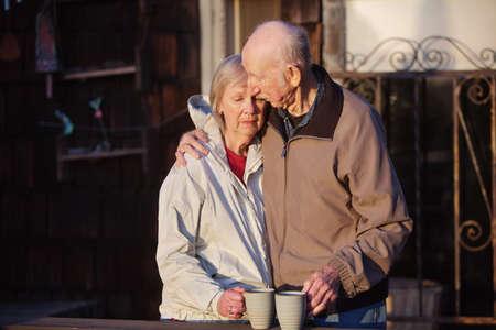 mourn: Depressed woman being held by senior man