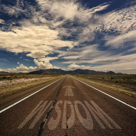 Conceptual image of desert road with the word wisdom and arrow Imagens