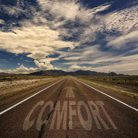 highway love: Conceptual image of desert road with the word comfort and arrow