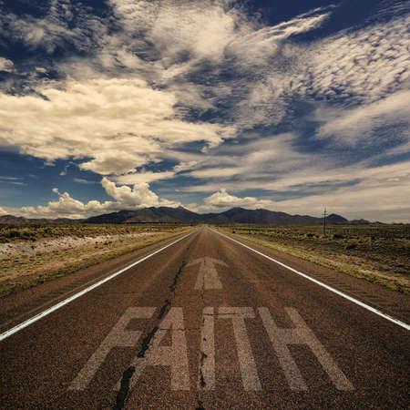 faith: Conceptual image of desert road with the word faith and arrow Stock Photo