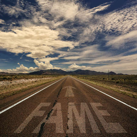 fame: Conceptual image of desert road with the word fame and arrow Stock Photo
