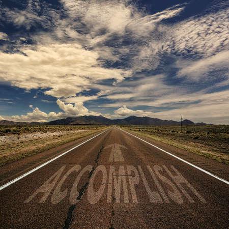 accomplish: Conceptual image of desert road with the word accomplish and arrow