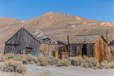 old mining building: Ghost town home ruins at Bodie in California