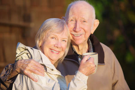 married: Happily married senior couple outdoors with coffee outdoors
