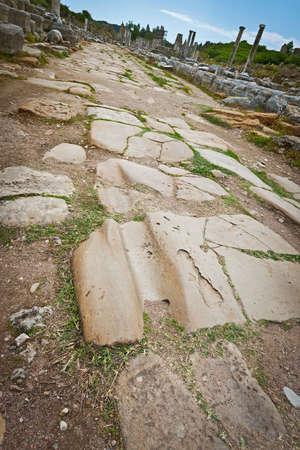 worn: Worn rut from many ancient chariots at historic Perga
