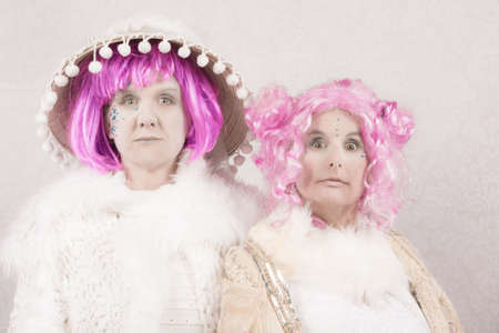 surreal: Surreal female circus style characters on white background Stock Photo