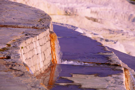 notch: Hot mineral spring water pouring from notch in wall at Pamukkale in Turkey