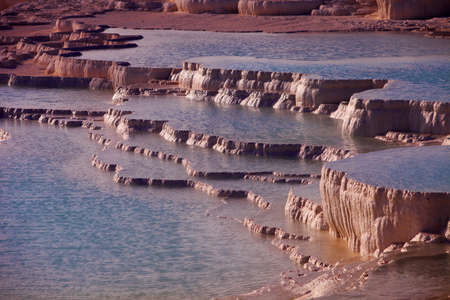 hot springs: Terraces formed by mineral rich hot springs water at Pamukkale in Turkey Stock Photo