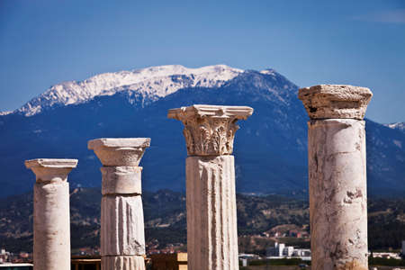 doric: Corinthian and Doric columns in front of snow capped mountains at Laodicea